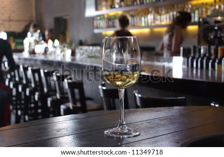 Lonely wine glass on a background of a bar