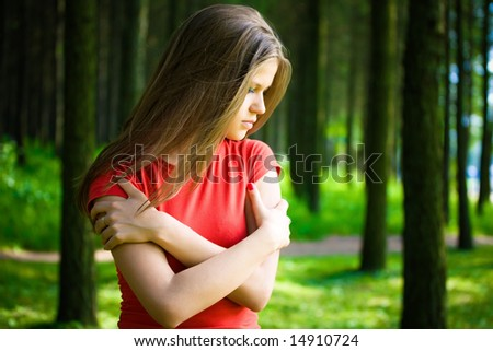 Lonely woman in a forest. - stock photo