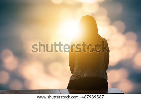 Lonely woman sitting alone moments sunset.are Lovely. Style abstract shadows.silhouette. On Blurred background bokeh. light Fair. Let's Stay Together