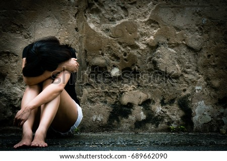Lonely woman sitting on the floor near old wall vintage tone,sad depression, violence, bipolar concept, hard contrast,soft focus #689662090
