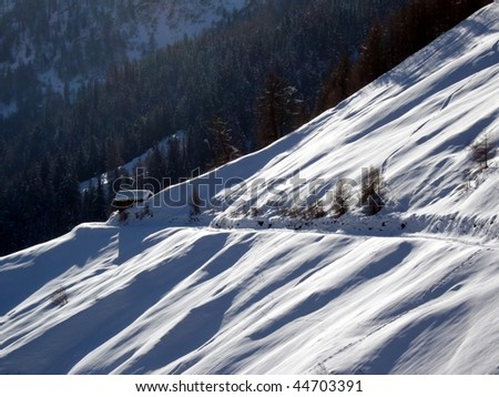 Lonely wooden skiing cabin in the snowy Alps