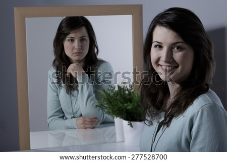Lonely young woman with bipolar personality disorder