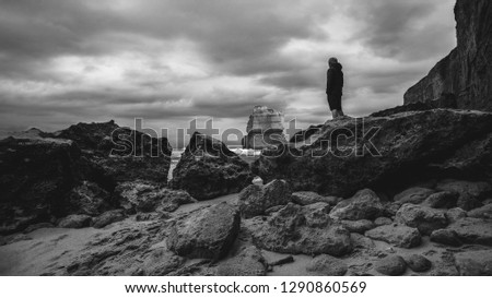 Lonesome Man looking 12 Apostels Australia cloudy sky low angle shot Black and White