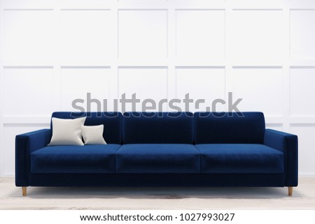 Long and comfortable dark blue sofa standing in a room with white walls and a light wooden floor. 3d rendering mock up