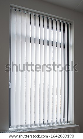 Long and white lamella curtains. Stock photo ©