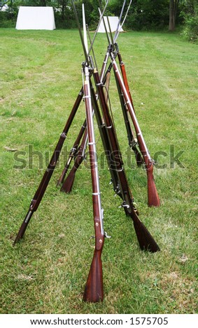 Long antique guns with bayonets from the american civil war period.
