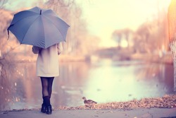 long background girl umbrella / horizontal view rainy autumn day young woman with umbrella