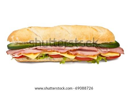 long baguette sandwich with lettuce, vegetables, ham, bacon and cheese on white background