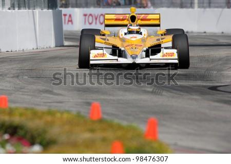 LONG BEACH - APRIL 17: Ryan Hunter-Reay driver of the #28 Andretti Autosport Team DHL / Sun Drop Citrus Dallara Honda races during the IndyCar Series Toyota Grand Prix on April 17 2011 in Long Beach. #98476307