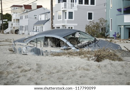 LONG BEACH ISLAND,NJ-NOVEMBER 1: A car is badly damaged by the storm surge and sand caused by  Hurricane Sandy in Holgate.Nov 1 2012, Long Beach Island, NJ