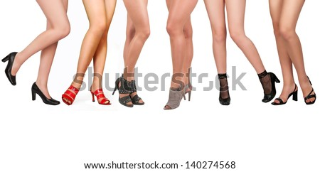 Long beautiful female legs, isolated on a white background