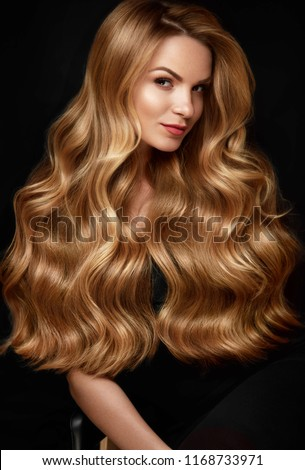 Long Blonde Hair. Woman With Wavy Hairstyle, Beauty Face
