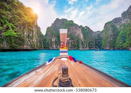 Long boat and blue water at Maya bay in Phi Phi Island, Krabi Thailand.