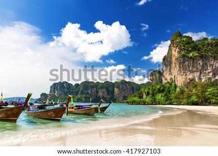 Long boats and Railay beach in Krabi Thailand