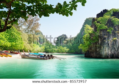 long boats on island in Thailand