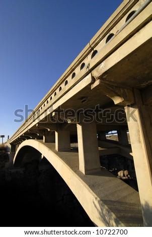 Long bridge trusses with blue sky - stock photo