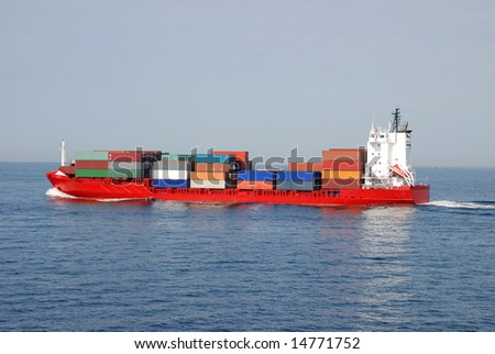 Long Cargo Ship Transporting Sea Containers Full of Goods
