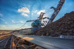 Long conveyor belt transporting ore