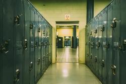 Long corridor full of lockers in a basement