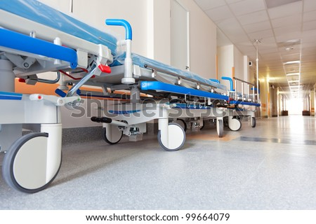 long corridor in hospital with surgical transport - stock photo