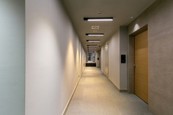 Long corridor interior in modern hotel