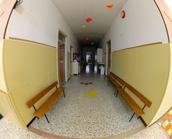 long corridor of a school without people by fisheye lens