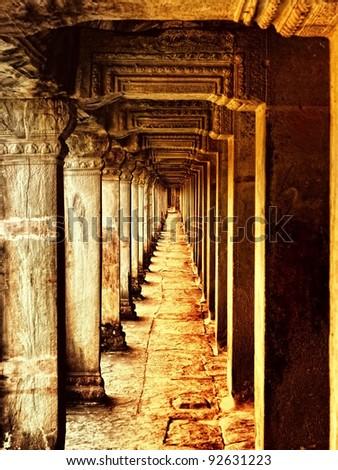 Long corridor of pillars in temple ruins, Angkor Wat, Cambodia