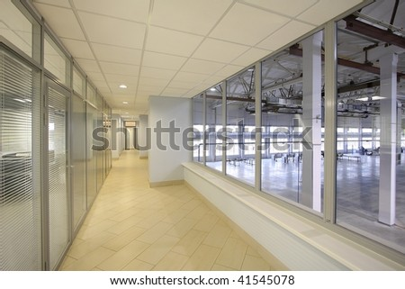 Long corridor with glass walls in style hi-tech - stock photo