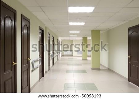 Long corridor with set of doors - stock photo