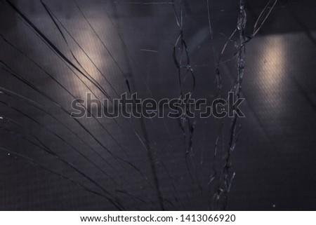 long cracks on broken glass close up. texture, background, wallpaper. #1413066920