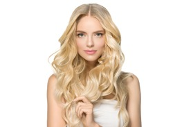 Long curly blonde hair woman with healthy skin and natural makeup isolated on white