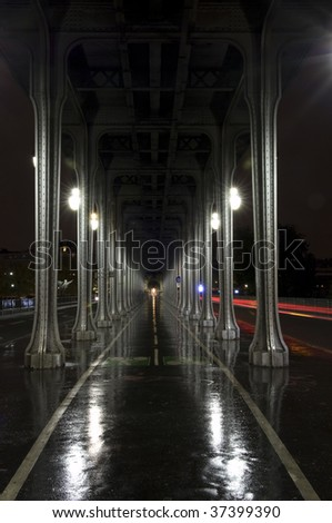 Long, dark alley at rainy night