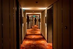 Long dark corridor in a luxury hotel