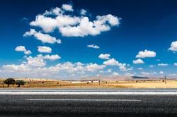 Long desert highway under the hot sun.