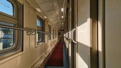 Long-distance train inside view. A compartment of a train carriage. Travel by rail