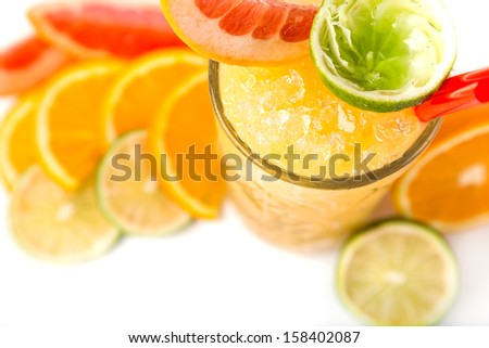 long drink orange coctail with citruses garnish