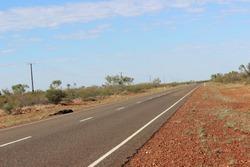 Long empty road Australian outback road red centre freedom on the road van life road kill red dirt blue clear skies