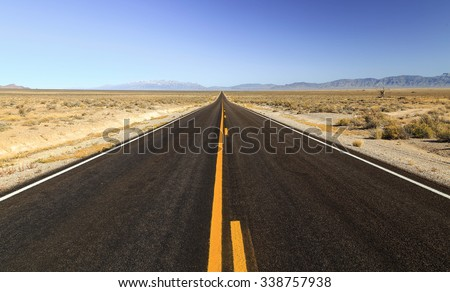 Long empty road in Nevada, USA.