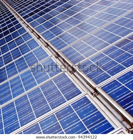 long endless row of blue solar panels to produce electricity