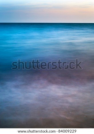 Long exposure abstract of ocean waves at the beach.