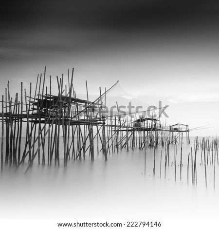 "Long exposure and black and white image of ""langgai""  , the traditional fishing medium at Malaysia ."