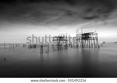 """Long exposure and black and white image of ruined """"langgai"""" , the traditional fishing medium at Malaysia"""