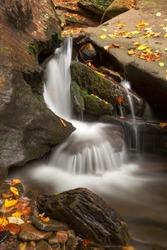 Long exposure autumn waterfall from Ricketts Glen State Park near Benton, Pennsylvania (USA).