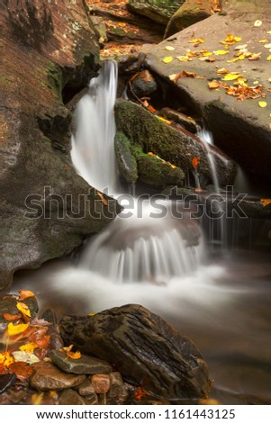 Long exposure autumn waterfall from Ricketts Glen State Park near Benton, Pennsylvania (USA).