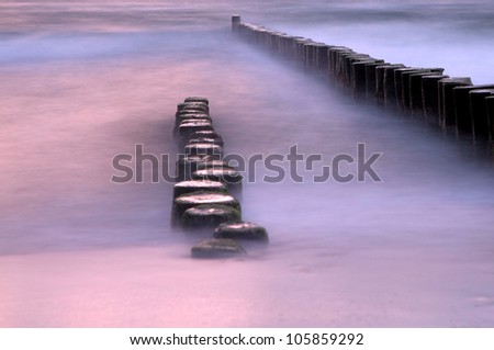 Long exposure breakwater,   Sunrise over the Baltic sea, Beautiful colorful summer scene full of warm colors