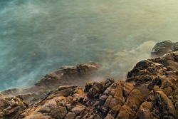 Long exposure detail of rocks and sea in tropical ocean, background or wallpeper, Natural relaxing vacation and business travel concept