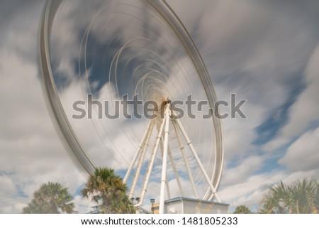 Long exposure ferris wheel in motion #1481805233