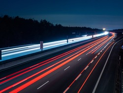 long exposure from a german autobahn at nighttime with lightrays of the carlights