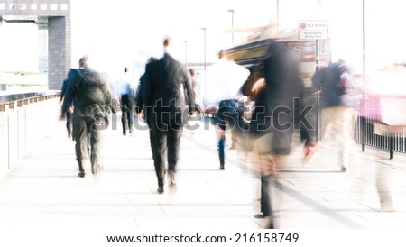 Long exposure, high key abstract captures of anonymous London City workers on their way to the office.  Intentional creative motion blur to indicate movement.