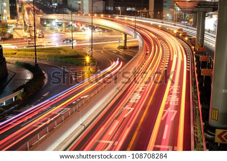 Long exposure image of cars rushing over a highway in central Tokyo, Japan at night
